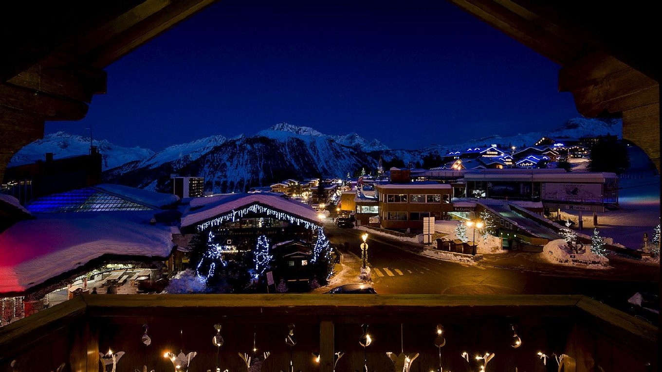 View on Courchevel Le Forum from the Luxury Chalet L'Arctique's balcony in Courchevel 1850 available for rental with your Agency In-Luxe Chalets France.