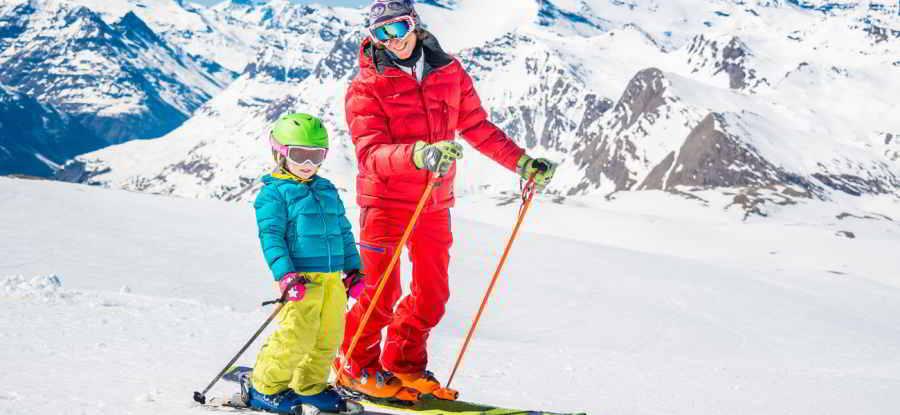 Val d'Isère ESF Ecole de Ski Française. Picture of a child having a ski lesson.