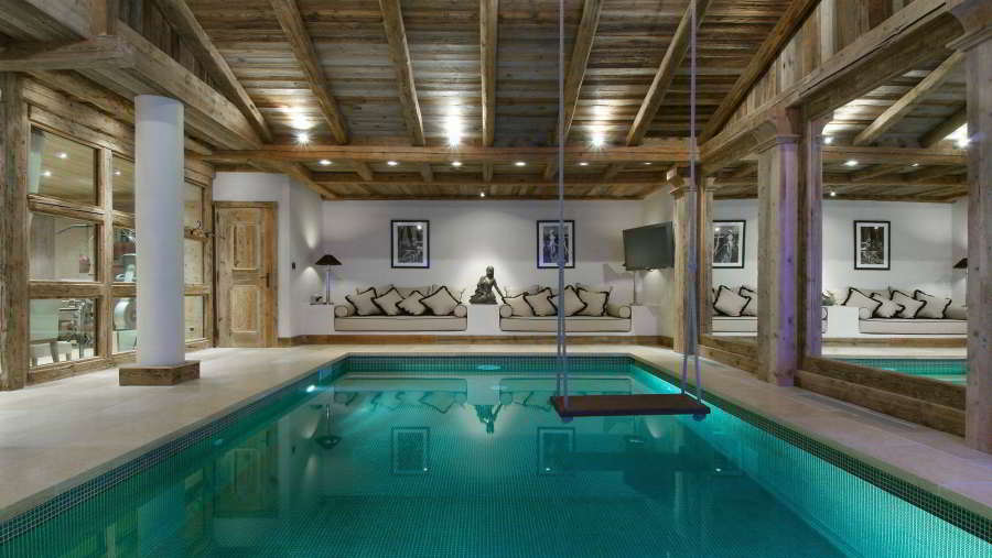 Indoor heated swimming pool at Luxury Chalet Grande Roche Courchevel 1850, for 14 people with fitness, sauna, steam room, outdoor jacuzzi, cinema, massage room and a chef; Chalet rental Courchevel 1850 with In-Luxe Chalets France